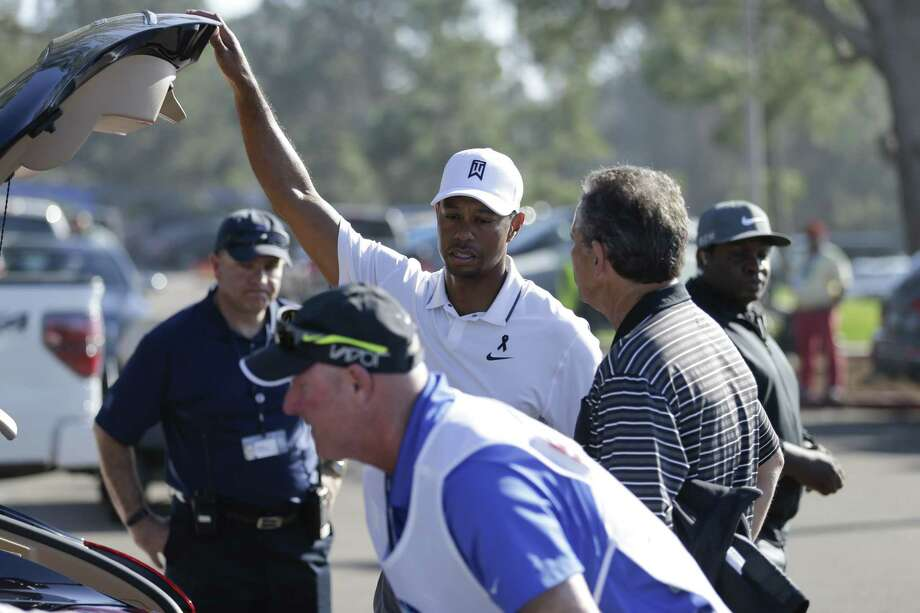 Tiger Woods loads his car after withdrawing in the first round of the Farmers Insurance Open Thursday in San Diego. Photo: Gregory Bull — The Associated Press  / AP