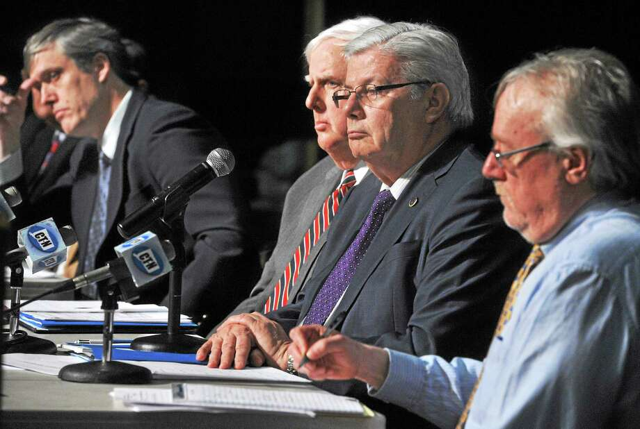 Connecticut Public Utilities Regulatory Authority members, from left, George Denning, chairman Arthur House, vice-chairman Jack Betkoski III and Frank Augeri Jr. listen to testimony at a March public hearing in Hamden about tree-trimming plans. Photo: Mara Lavitt — New Haven Register   / Mara Lavitt