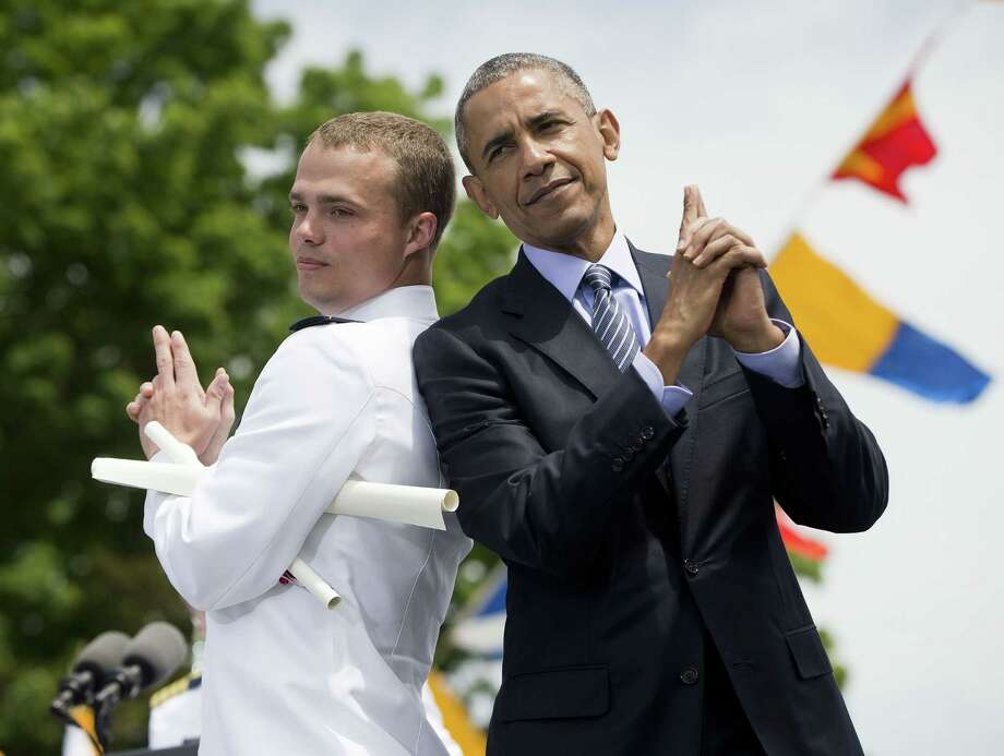 In this May 20, 2015 photo, President Barack Obama and Ensign Robert Huntley McConnel strike a pose after he received his diploma and commission at the U.S. Coast Guard Academy graduation in New London, Conn. Photo: AP Photo/Pablo Martinez Monsivais  / AP