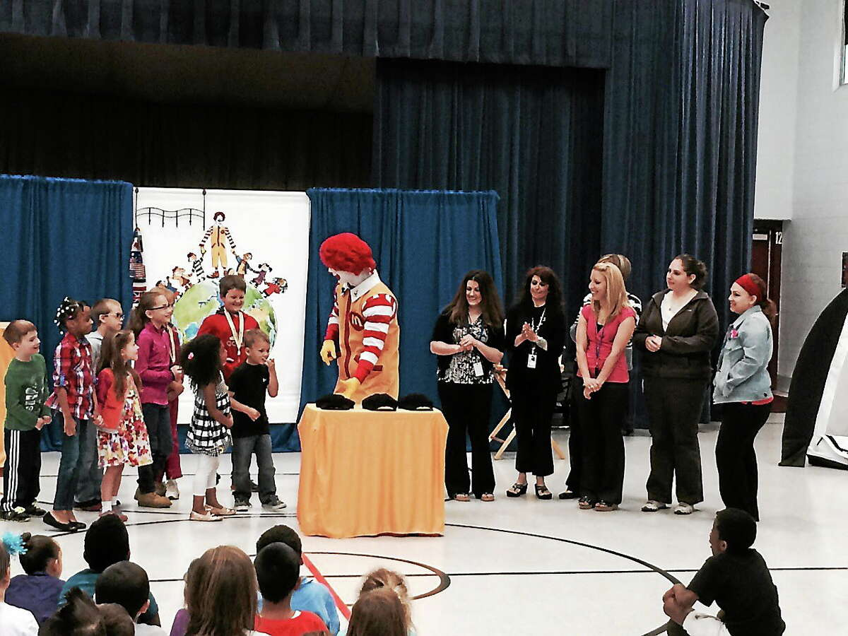 """Ronald McDonald, shown in this file photo, visited Farm Hill Elementary students in Middletown to perform """"A Friendship Adventure"""" show, which teaches children about friendship, cooperation, active play and anti-bullying."""