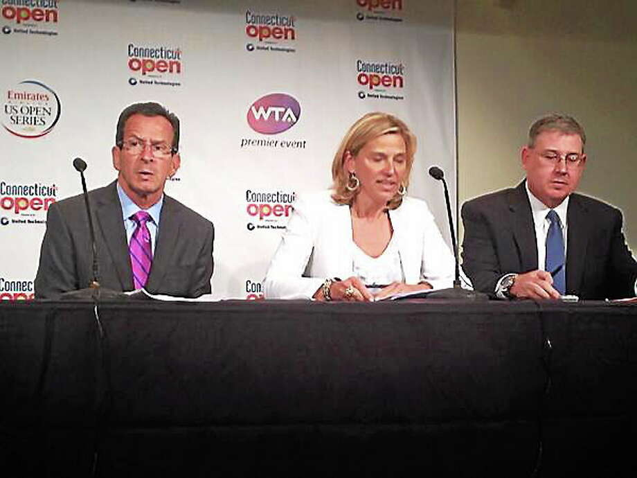 From left, Gov. Dannel P. Malloy, tournament director Anne Worcester and United Technologies senior vice president Charles Gill sit at the press conference Tuesday in which it was announced UTC would become the title sponsor of the newly renamed Connecticut Open. Photo: Chris Hunn — Register