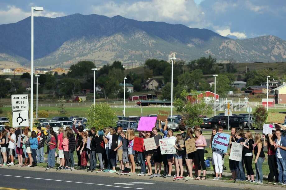 In this Sept. 23, 2014 photo, high school students hold a protest against a Jefferson County School Board proposal to emphasize patriotism in the teaching of U.S. history, at Ralston Valley High School, in Arvada, Colo. Photo: Brennan Linsley — The Associated Press  / AP