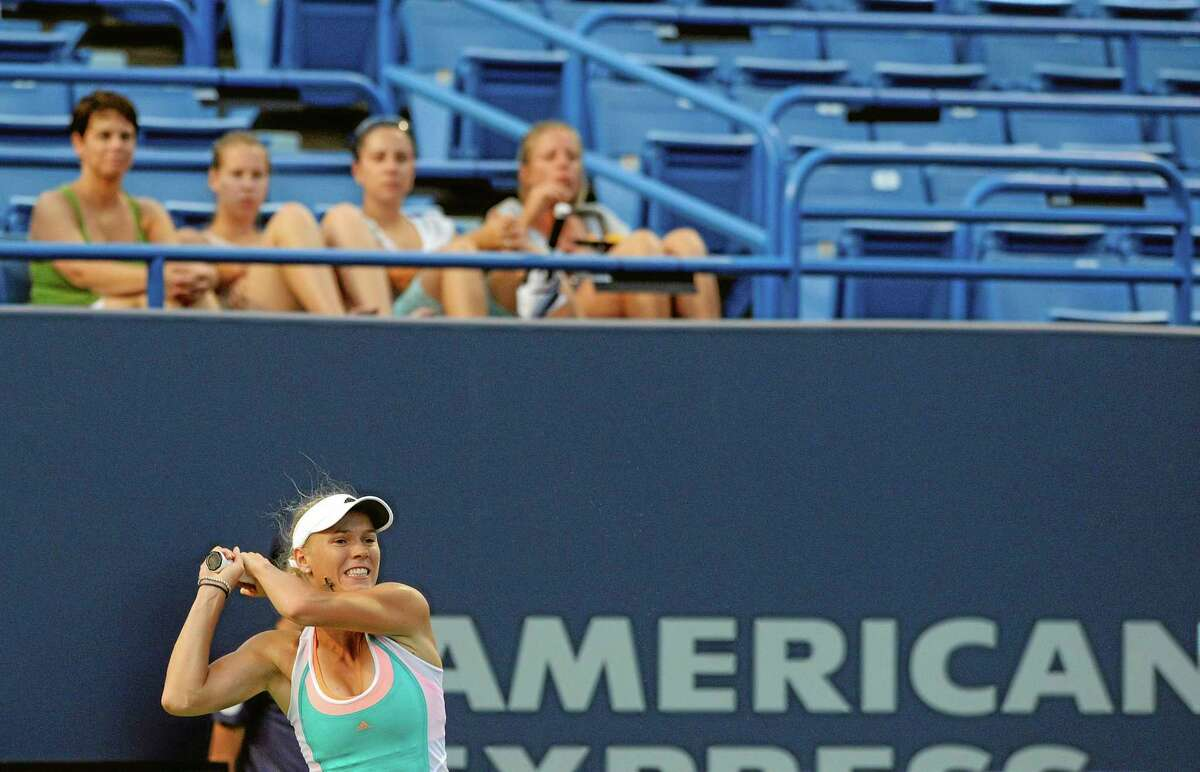 In this Aug. 22, 2013 file photo, Caroline Wozniacki follows through on a return shot during a match at the New Haven Open.