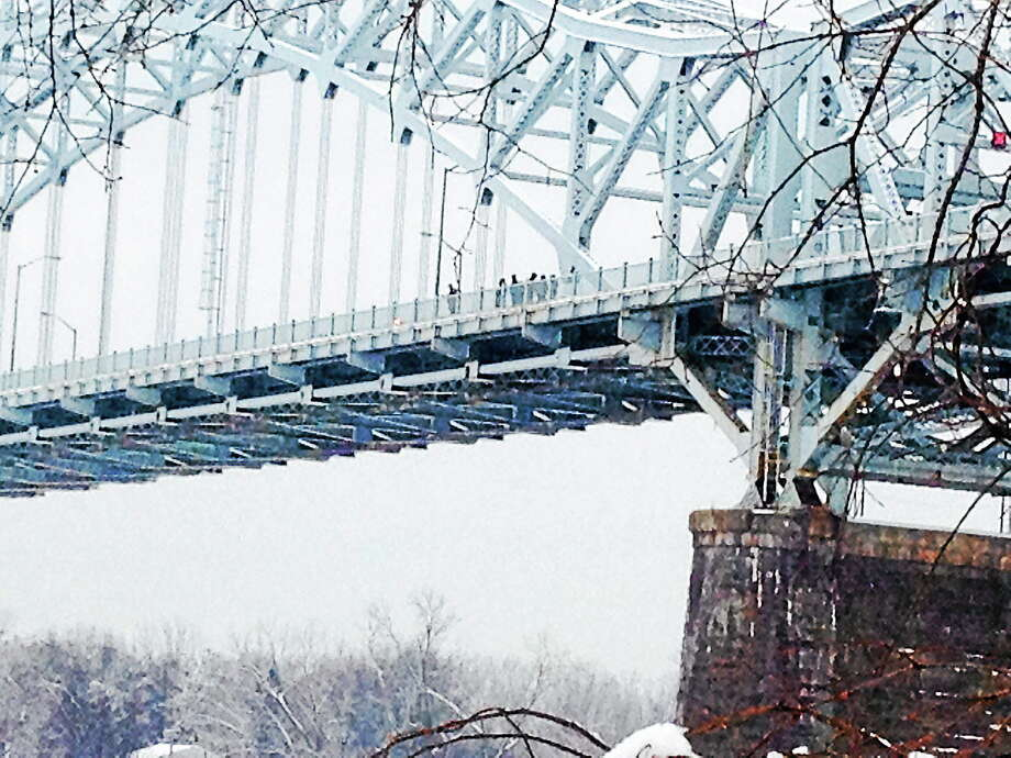 Officials are investigating on the Arrigoni Bridge Wednesday. Photo: Michael T. Lyle Jr. — The Middletown Press