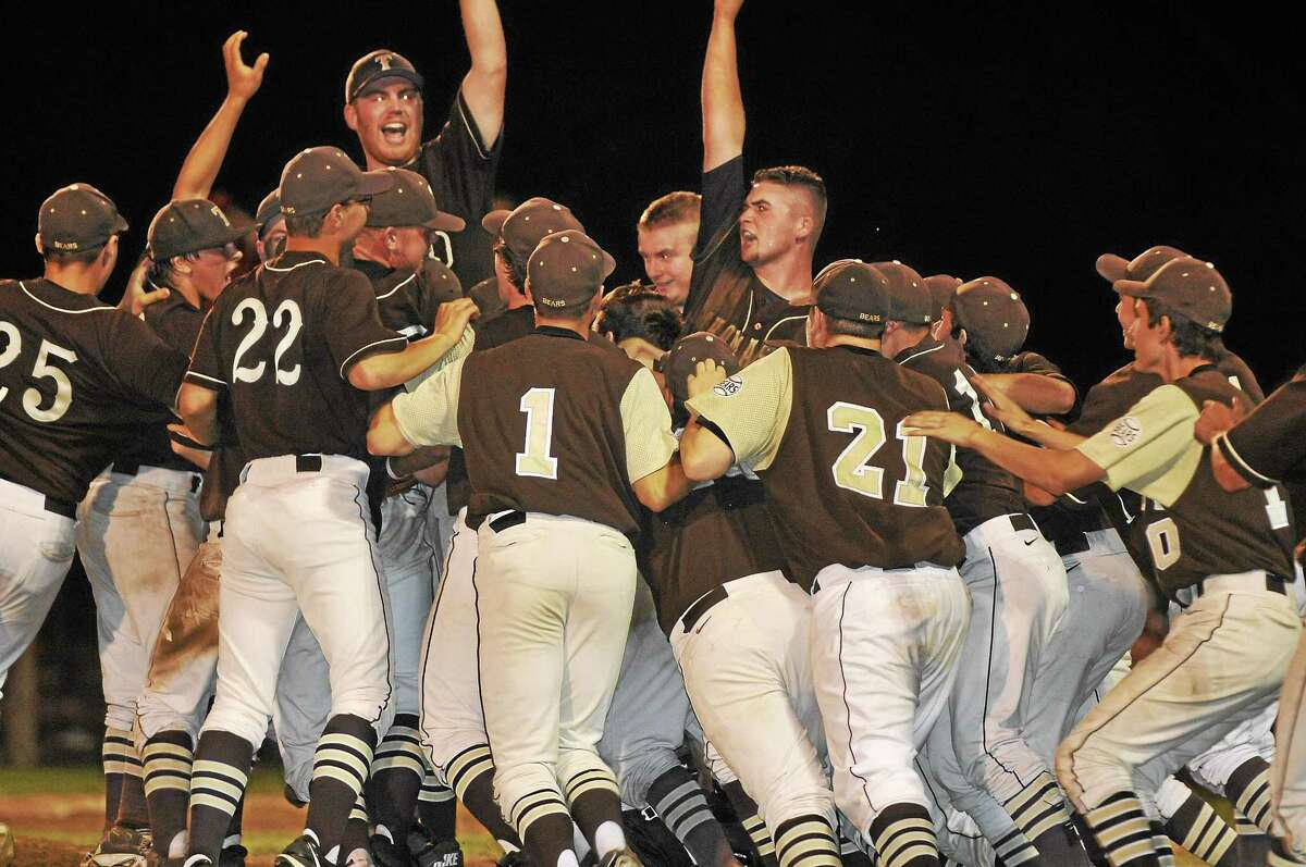 The Thomaston Golden Bears celebrate following their 5-4 victory over Cromwell in the Class S semifinals Tuesday night.