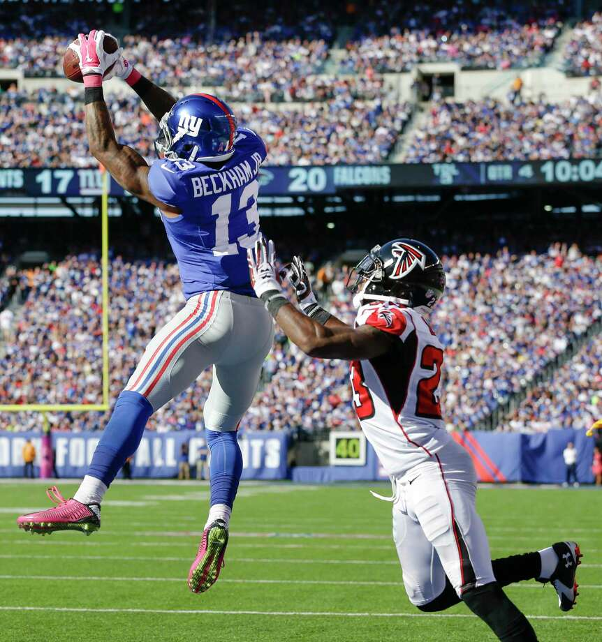 Giants rookie Odell Beckham Jr. catches a pass in front of Falcons cornerback Robert Alford during Sunday's game at MetLife Stadium. Photo: Seth Wenig — The Associated Press  / AP