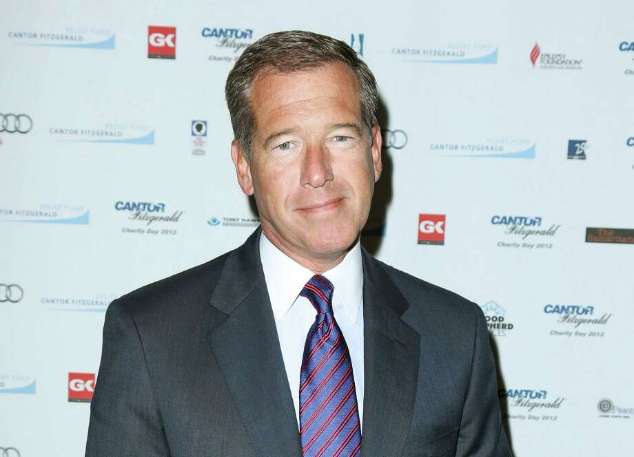 "FILE - This Sept. 11, 2012 file image released by Starpix shows Brian Williams at the Cantor Fitzgerald Charity Day event in New York. NBC ""NBC ""Nightly News"" anchor Williams has admitted he spread a false story about being on a helicopter that came under enemy fire while he was reporting in Iraq in 2003. Williams said on ""Nightly News"" on Wednesday, Feb. 4, 2015, he was in a helicopter following other aircraft, one of which was hit by ground fire. His helicopter was not hit. (AP Photo/Starpix, Andrew Toth, File) Photo: AP / Starpix"