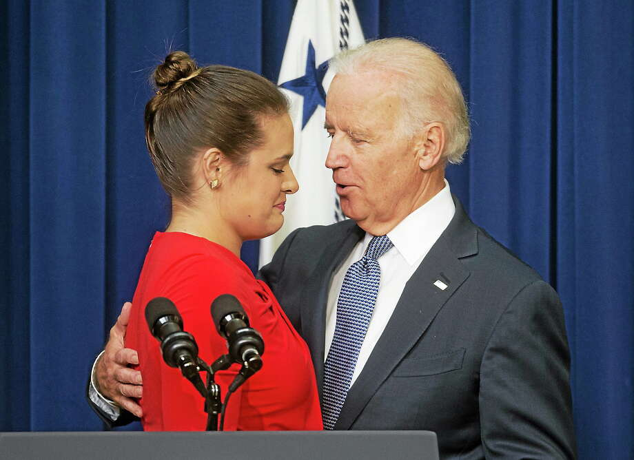 Vice President Joe Biden consoles Madeleine Smith after she recounted her story of being a raped victim while a student at Harvard University, during an event announcing the release of the First Report of the White House Task Force to Protect Students from Sexual Assault on April 29, 2014 at the White House complex in Washington. Photo: AP Photo  / AP
