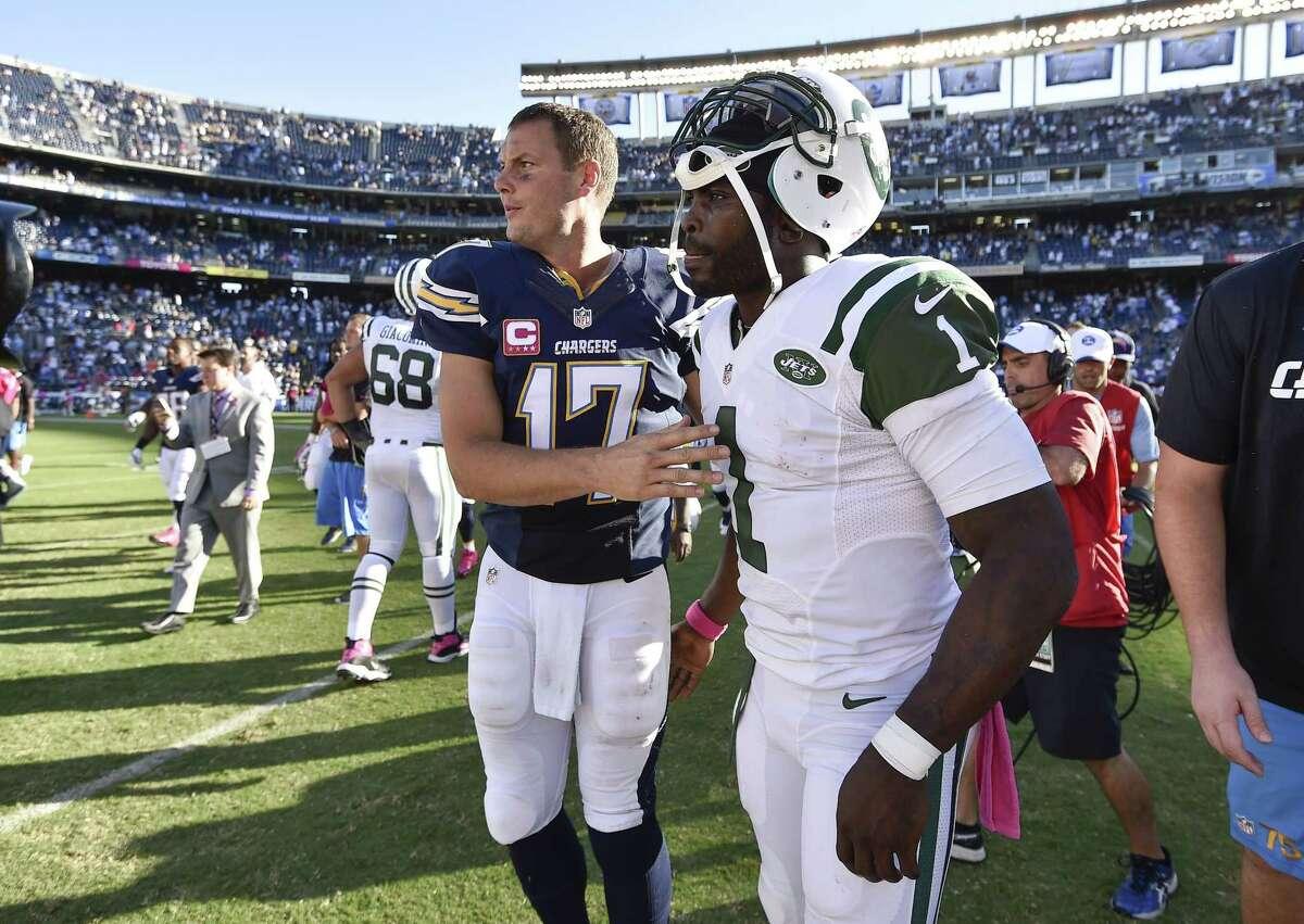Chargers quarterback Philip Rivers, left, greets Jets quarterback Michael Vick after Sunday's game.
