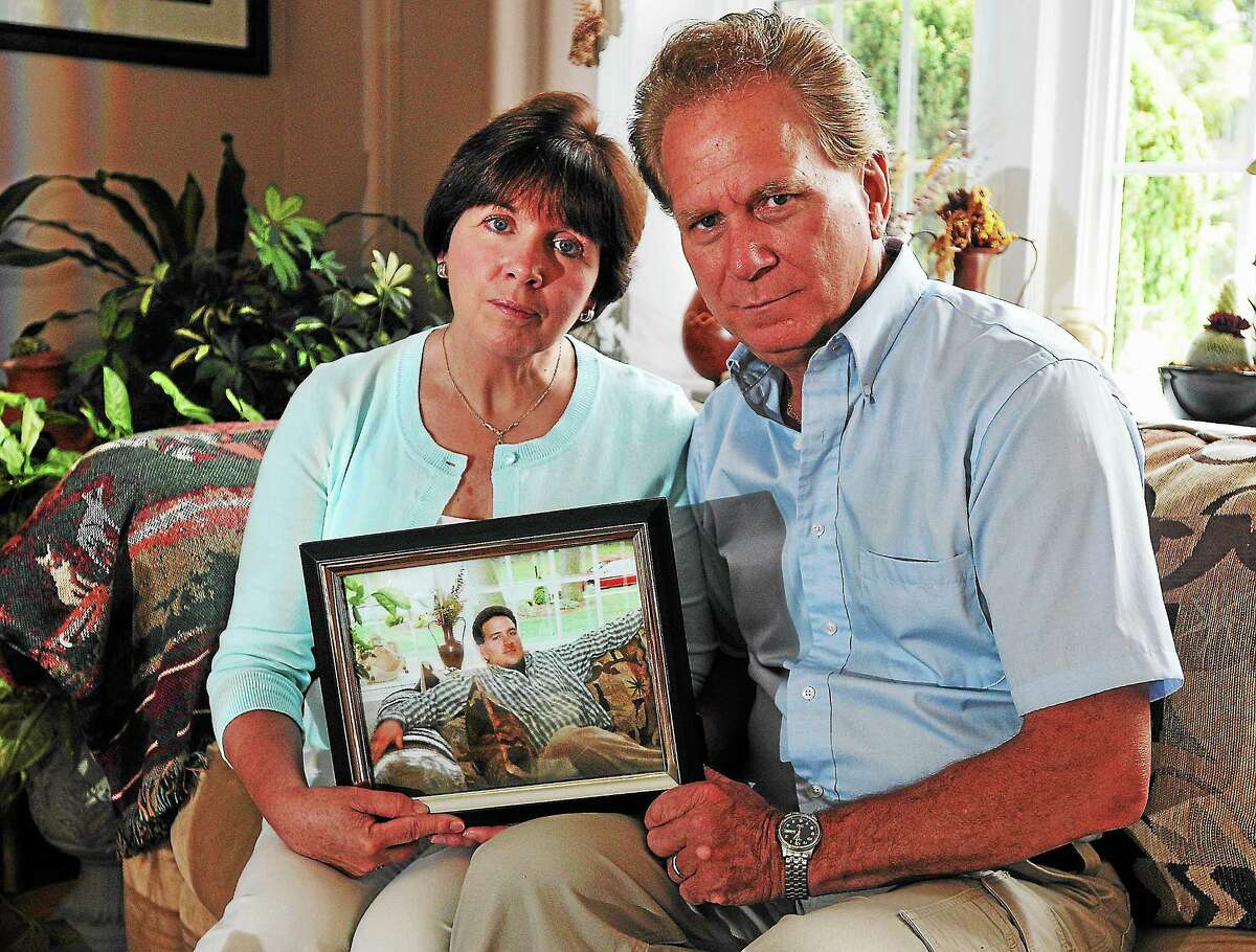 PETER CASOLINO — NEW HAVEN REGISTER FILE PHOTO Jan and Bill Smolinski with a photo of their son, Billy, who has been missing since 2004.