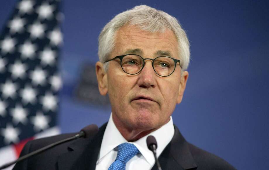 U.S. Secretary of Defense Chuck Hagel speaks during a media conference at NATO headquarters in Brussels on Thursday, Feb. 5, 2015. NATOís chief announced Thursday the alliance is set to more than double the size of its Response Force in response to Russian aggression in Ukraine and the challenge of Islamic extremism. NATO secretary-general Jens Stoltenberg, speaking to reporters before the opening of a meeting of defense ministers, said they were expected to agree to boost the size of the force from 13,000 to 30,000. (AP Photo/Virginia Mayo) Photo: AP / AP