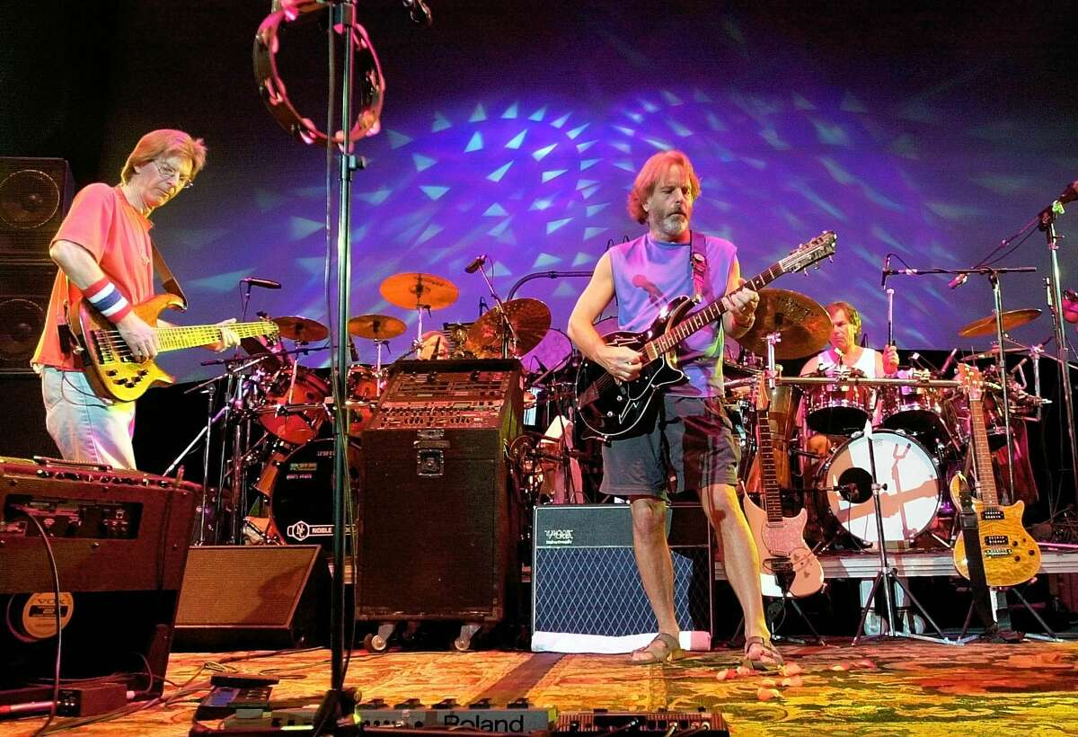 In this Aug. 3, 2002 photo, The Grateful Dead, from left, Phil Lesh, Bill Kreutzmann, Bob Weir and Mickey Hart perform during a reunion concert in East Troy, Wis. Mickey Hart, Bill Kreutzmann and Bob Weir have joined forces with John Mayer to form the band, Dead & Company. They will perform a show on Oct. 31 at Madison Square Garden in New York.