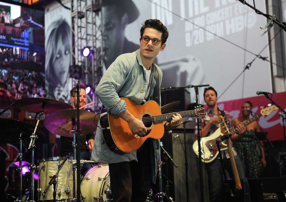 In this Sept. 26, 2014 photo, musician John Mayer performs at the Rock In Rio USA event in Times Square in New York.