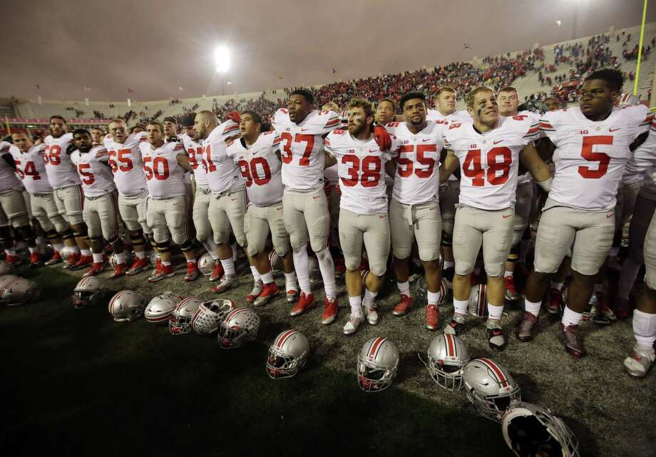 "Ohio State players sing ""Carmen Ohio"" after defeating Indiana on Saturday. Photo: Darron Cummings —  The Associated Press  / AP"