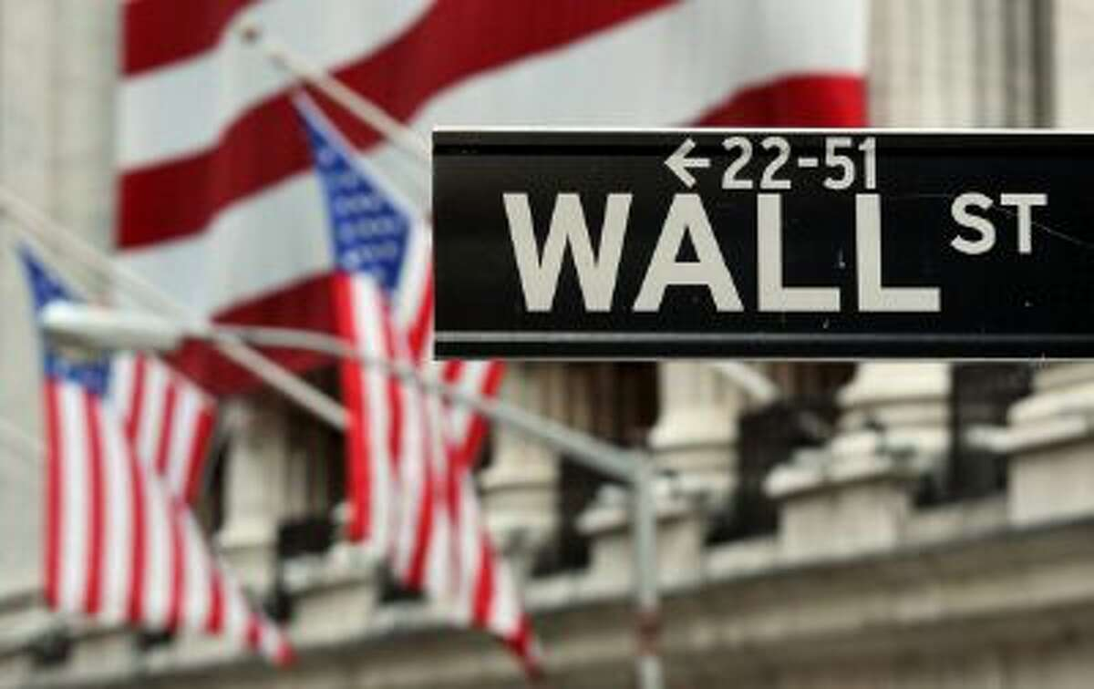 The Wall Street sign near the front of the New York Stock Exchange August 5, 2011. AFP PHOTO/Stan HONDA (Photo credit should read STAN HONDA/AFP/Getty Images)