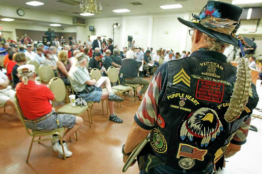 Vietnam veteran Ron Silver Eagle D'Andre, right, listens during a town hall meeting at American Legion Post 1 on Monday, June 9, 2014, in Phoenix concerning health-care issues at the Phoenix Veterans Affairs facilities. One Veterans Affairs Department health care system in Arizona has been flagged for further review following a nationwide audit of the agency's troubled appointment process, according to a report released Monday. (AP Photo/Ralph Freso) Photo: AP / FR170363 AP