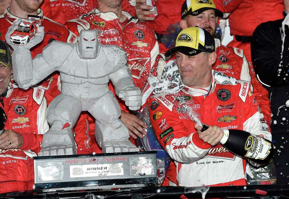 Kevin Harvick celebrates in Victory Lane after winning Sunday at Dover International Speedway. Photo: Nick Wass —  The Associated Press  / FR67404 AP