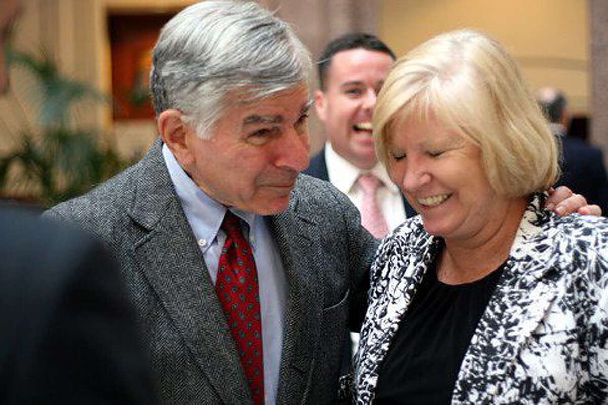 Former presidential candidate and Mass. Gov. Michael Dukakis jokes with state Rep. Ellen O'Brien, who died overnight.