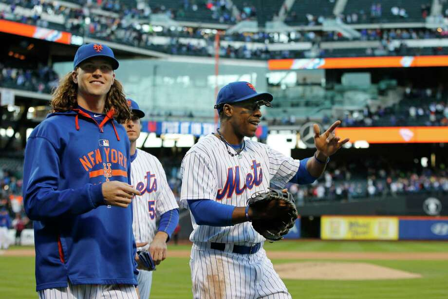 From left, Mets starting pitcher Jacob deGrom, Kelly Johnson, and Curtis Granderson celebrate after the Mets shut out the Nationals 1-0 on Sunday. Photo: Kathy Willens —  The Associated Press  / AP