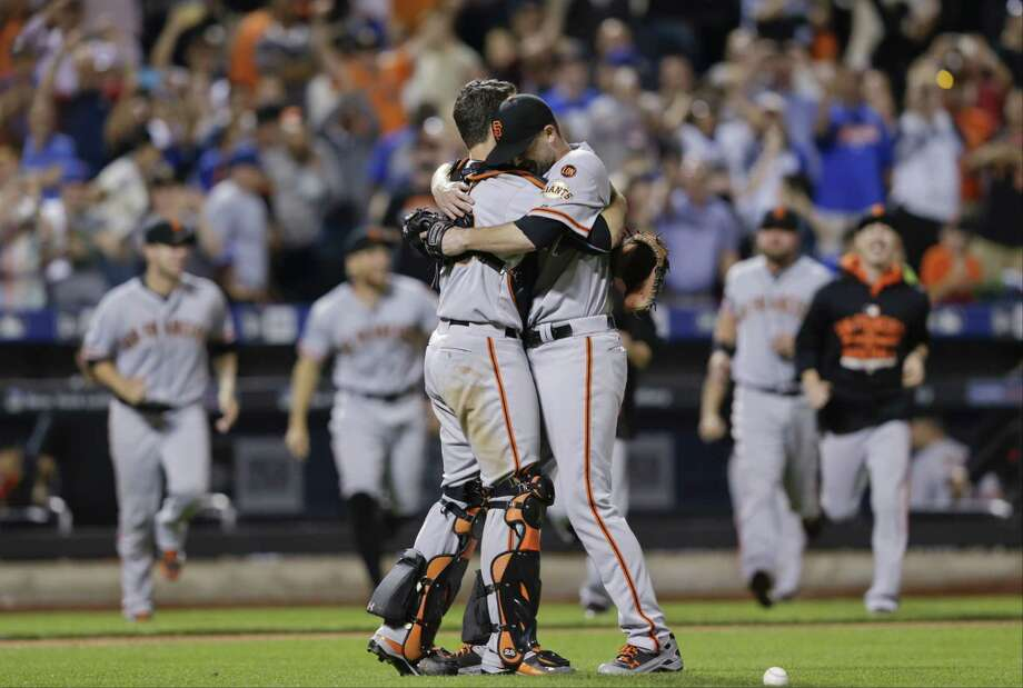 San Francisco Giants starting pitcher Chris Heston hugs catcher Buster Posey, left, after Heston's no-hitter against the New York Mets on Tuesday. The Giants won 5-0. Photo: Frank Franklin II  — The Associated Press  / AP
