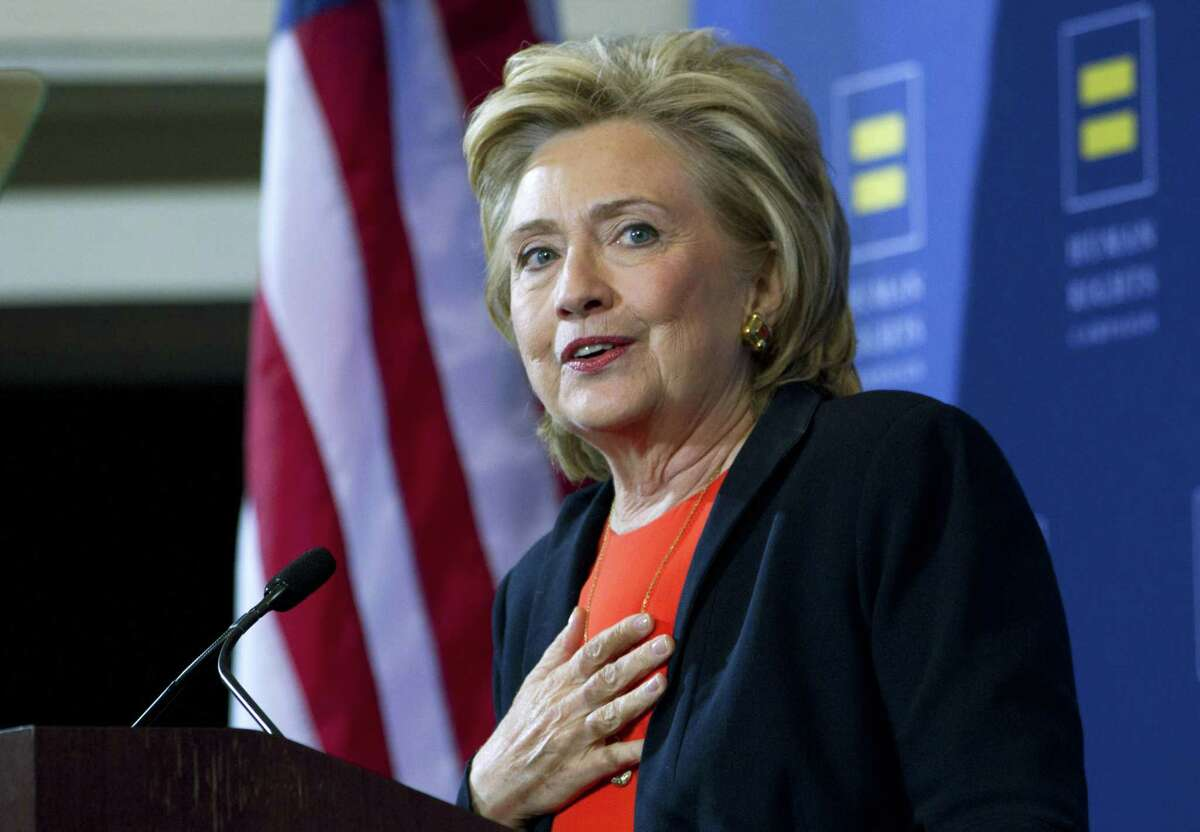 Democratic presidential candidate Hillary Rodham Clinton gestures as she speaks at Human Rights Campaign gathering in Washington, Saturday, Oct. 3, 2015.