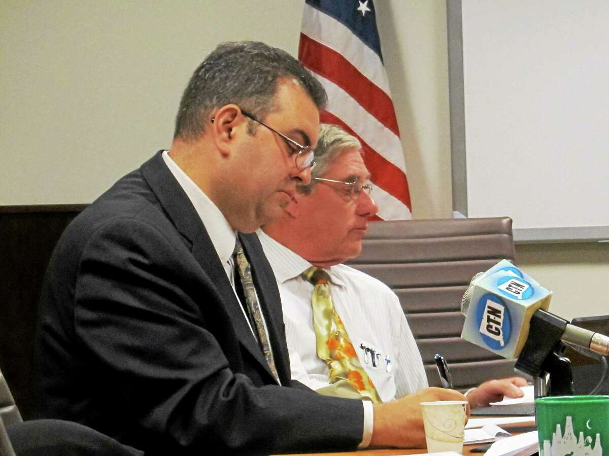 Michael Brandi, general counsel and executive director of the State Elections Enforcement Commission, and Commissioner Stephen Penny, are shown in this file photo.