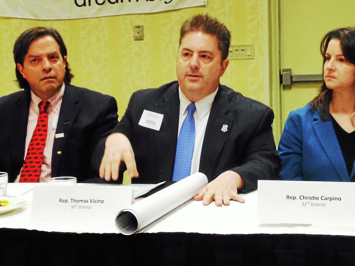 State Rep. Thomas Vicino, D-35, center, speaks at the Middlesex Chamber of Commerce Legislative Committee breakfast Friday in Cromwell.