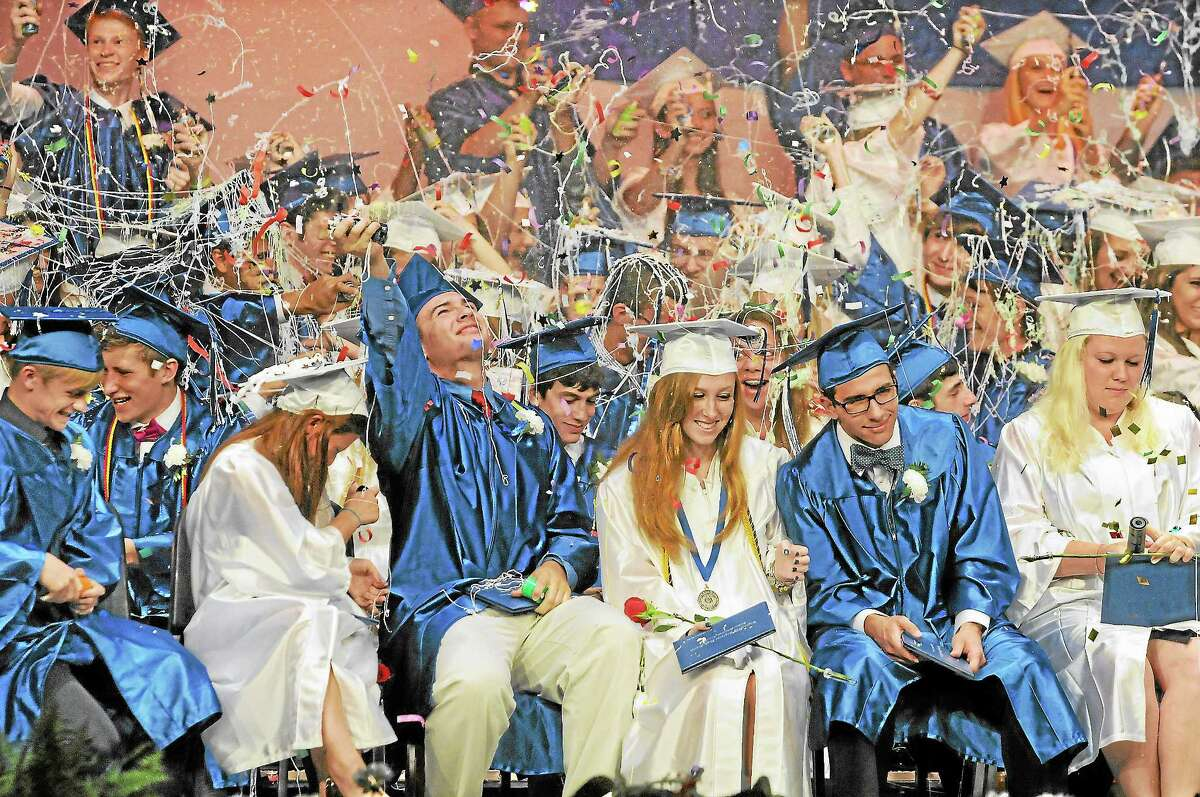 Coginchaug's class of 2013 celebrate with silly string and beach balls after receiving their diplomas at the Julian B. Thayer Auditorium Tuesday night at graduation.