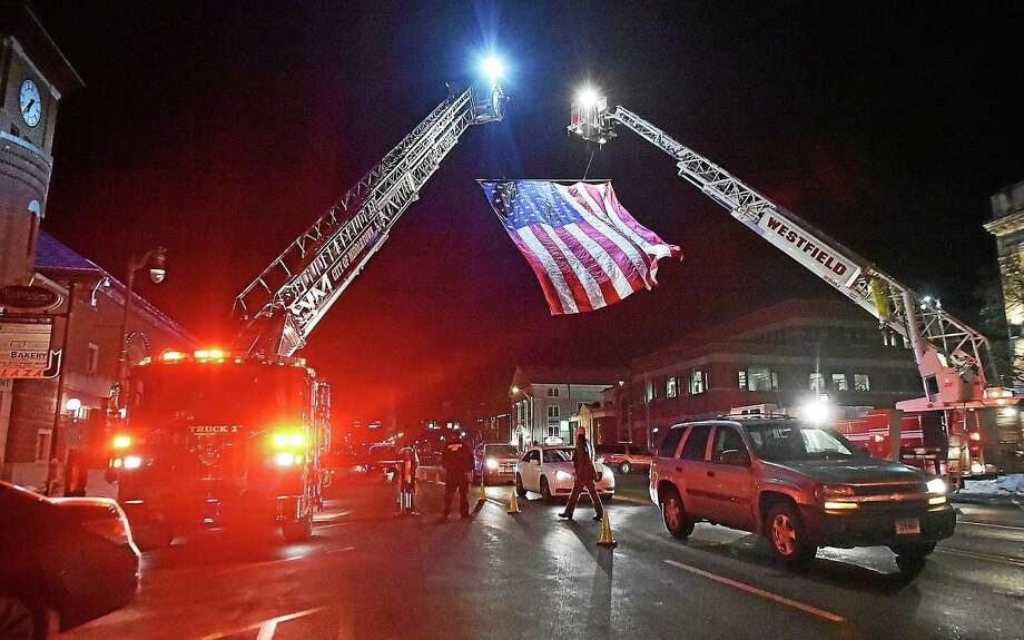 Middletown fire and police personnel turned out Wednesday to mark 15 years since the death of Sgt. George R. Dingwall with a ceremony and procession on Main Street and Dingwall Drive. Photo: Catherine Avalone — The Middletown Press  / New Haven RegisterThe Middletown Press