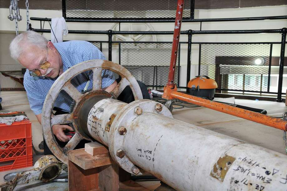 "Professor Frederick Orthlieb, a mechanical engineer works on the declination axel which was added to the 20"" Alvan Clark refracting telescope at the Van Vleck Observatory at Wesleyan University in the 1960's. The restoration is expected to be completed September 1, 2015. Photo: Catherine Avalone — The Middletown Press  / TheMiddletownPress"