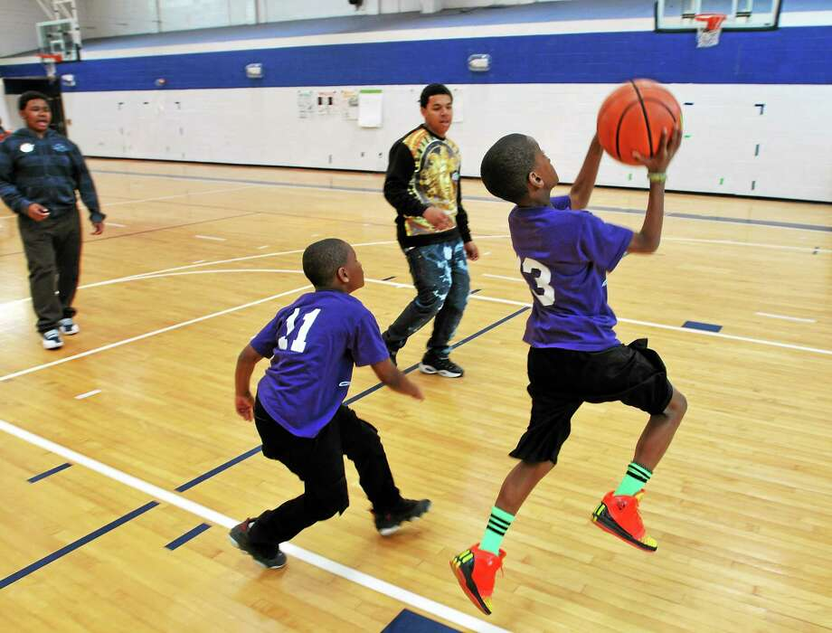 Children in elementary and middle school in Cromwell are welcome to register for youth basketball through the recreation department. Photo: File Photo