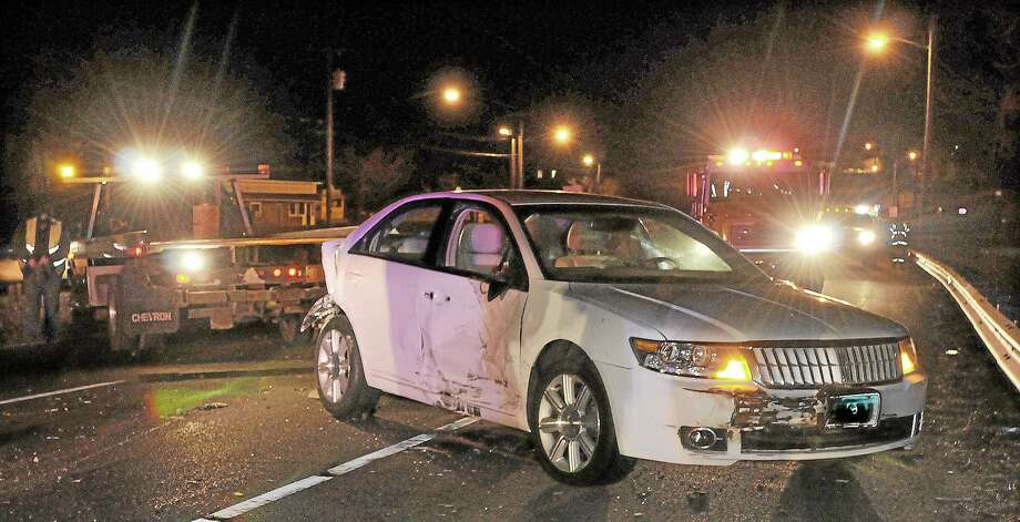 This March 2013 archive photograph shows damage to the four-door sedan that collided with a pick-up truck in the eastbound lane on Route 66 in Portland. Photo: File Photo  / TheMiddletownPress