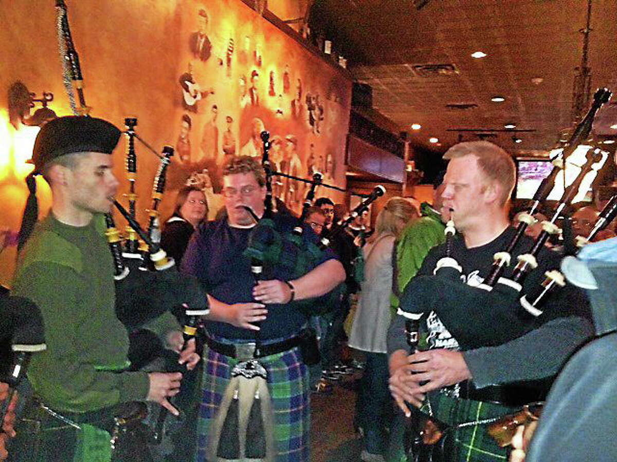 Bagpipers perform at last year's Pipers' Pub Crawl in Middletown. Local resident Peter Dunbar is hosting the event next month to raise awareness for Huntington's Disease.