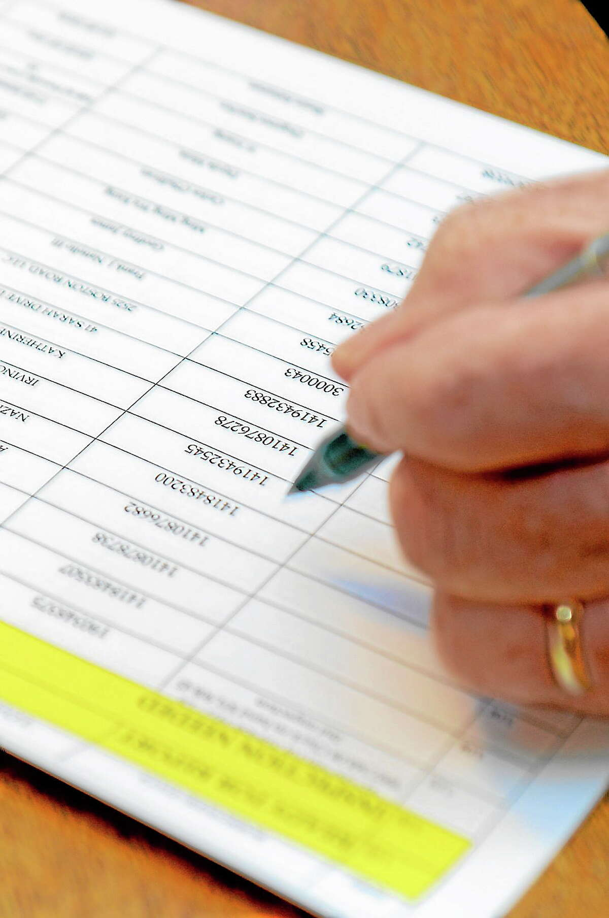 Tania Barricklo-Daily Freeman Jim Dougherty works from a list of participants in the Shady-Bearsville email community.