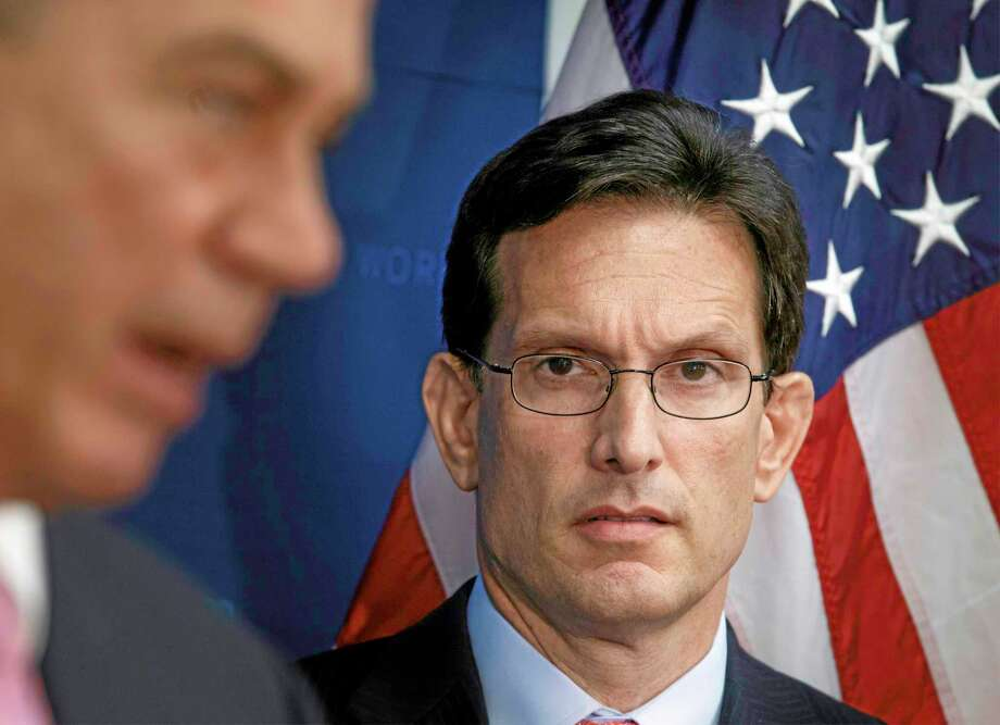House Majority Leader Eric Cantor of Va., listens at right as House Speaker John Boehner of Ohio, during a news conference on Capitol Hill in Washington, Tuesday, June 10, 2014. Photo: (AP Photo/J. Scott Applewhite) / AP
