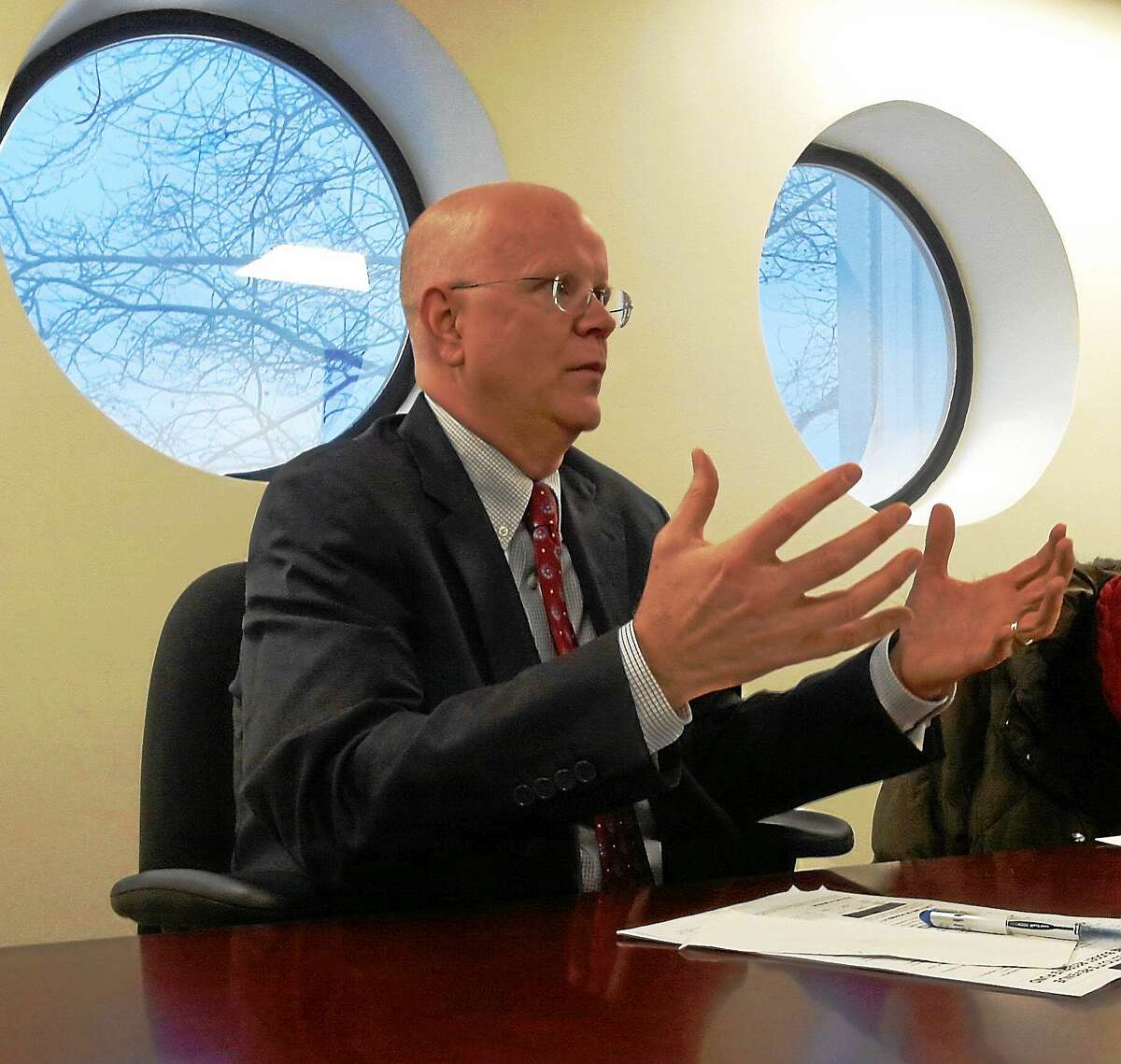 Connecticut Comptroller Kevin Lembo makes a point during an editorial board meeting at the New Haven Register.