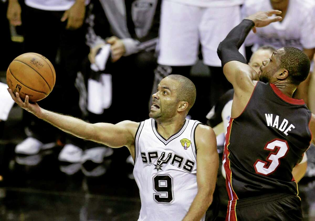San Antonio Spurs guard Tony Parker shoots against Miami Heat guard Dwyane Wade during Game 2 of the NBA Finals.