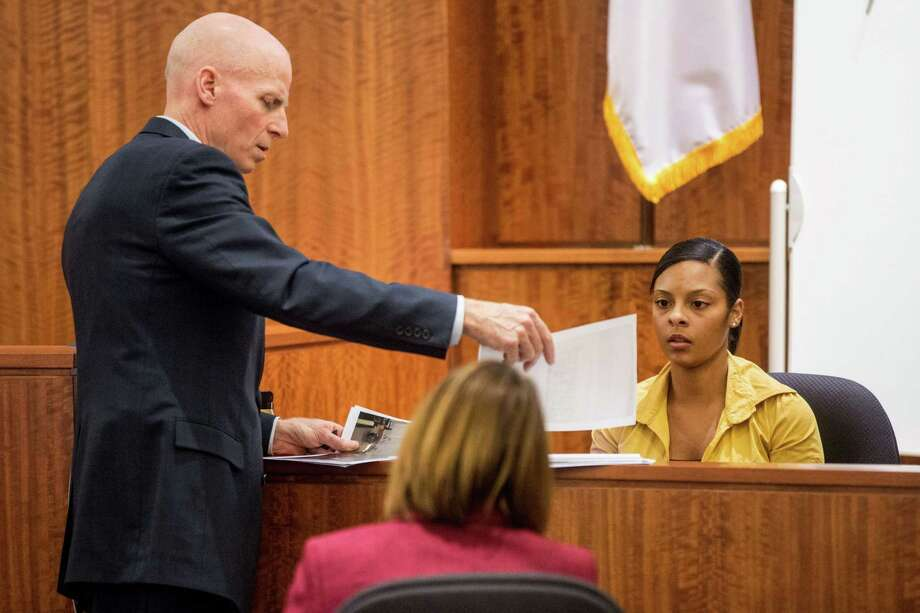 Assistant district attorney William McCauley, left, questions Shaneah Jenkins, right, during the murder trial of former New England Patriots player Aaron Hernandez at Bristol County Superior Court in Fall River, Mass. Photo: Aram Boghosian — The Boston Globe  / The Boston Globe Pool