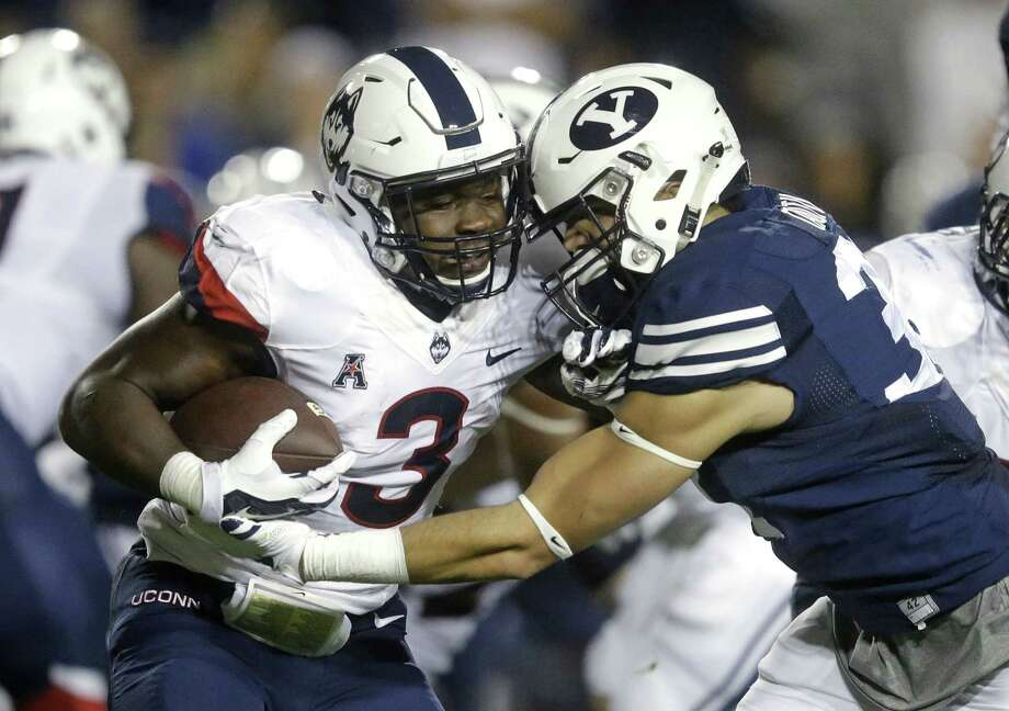 BYU linebacker Sae Tautu, right, tackles Connecticut running back Ron Johnson (3) in the first half during an NCAA college football game Friday, Oct. 2, 2015, in Provo, Utah. (AP Photo/Rick Bowmer) Photo: AP / AP