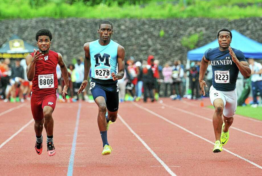 Middletown's Kareem Bracket-Woodbury, shown running in the 100 meter dash trials, finishing in fifth place in the 100 meter dash finals. Photo: Peter Casolino — New Haven Register
