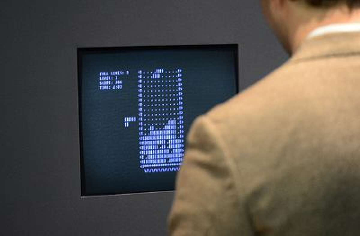 A visitor plays the video game Tetris (1984) during an exhibition preview featuring 14 video games acquired by The Museum of Modern Art (MoMA) in New York, March 1, 2013. The MoMA acquired 14 video games entering its collection as part of an ongoing research on interaction design. AFP PHOTO/EMMANUEL DUNAND (Photo credit should read EMMANUEL DUNAND/AFP/Getty Images)