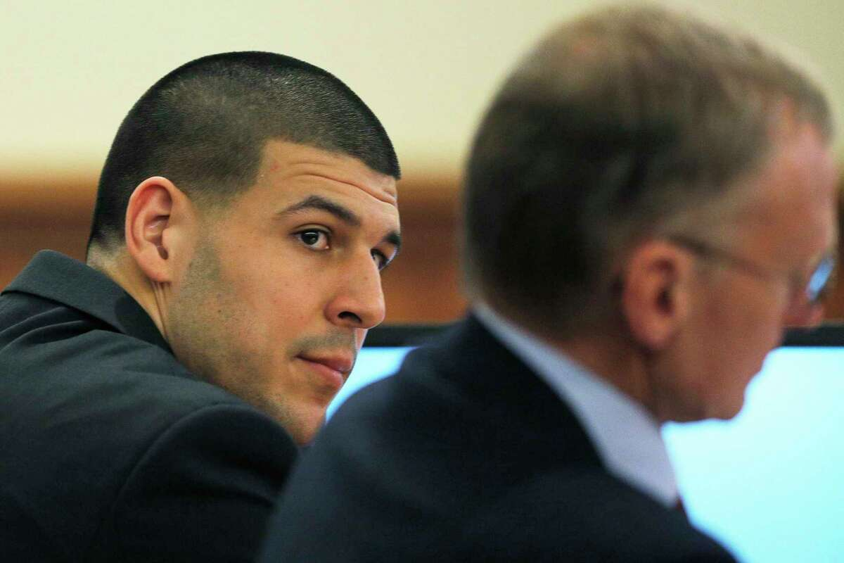 Aaron Hernandez, left, and his attorney Charles Rankin listen to testimony during Hernandez's murder trial Wednesday at Bristol County Superior Court in Fall River, Mass.