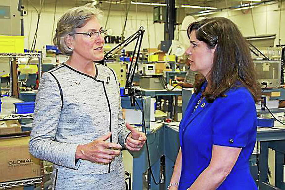 State Sen. Danté Bartolomeo speaks with Carol Wallace, CEO of Cooper Atkins in Middlefield. Cooper Atkins manufactures tools to measure time, temperature, and humidity that are sold to companies around the year. The company was recently awarded the President's Award for Exports in Washington, D.C., for growing its exports by 36 percent in the last four years. Photo: Submitted Photo