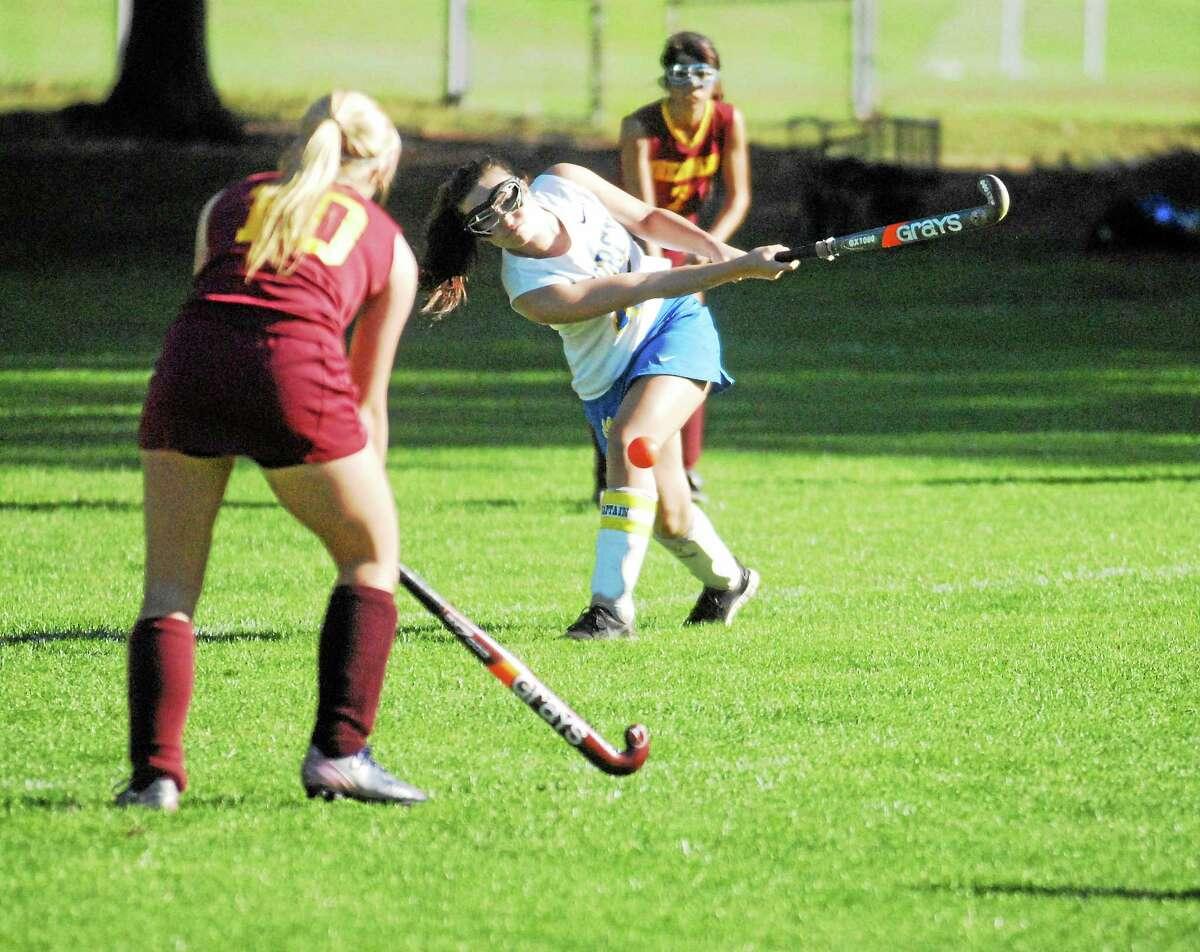 Mercy senior Juliana DellaCamera drives the ball upfield against Sheehan defender Marissa Staiger on Friday.