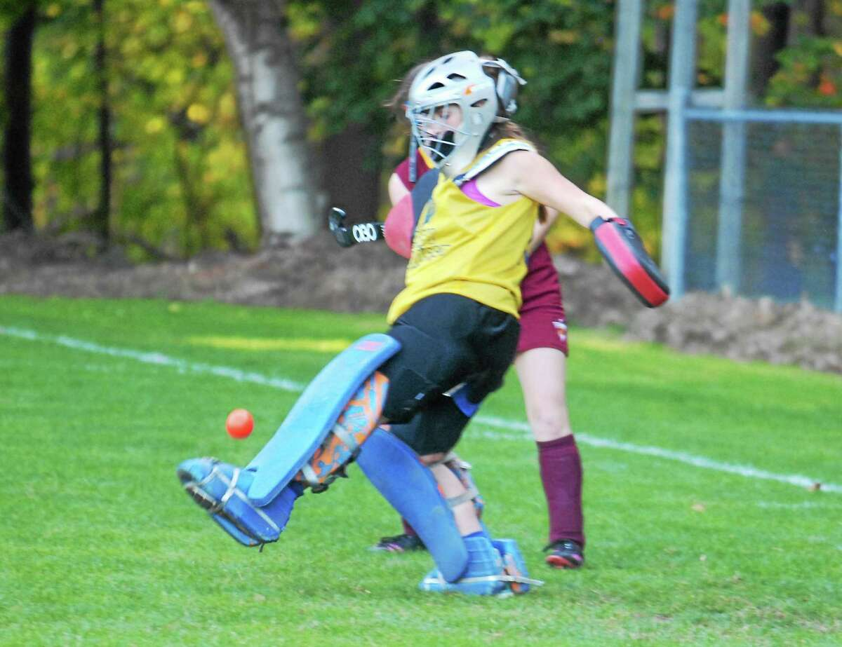 Mercy junior goalie Shannon Murphy makes one of her eight saves against Sheehan on Friday. The Titans won 3-2.