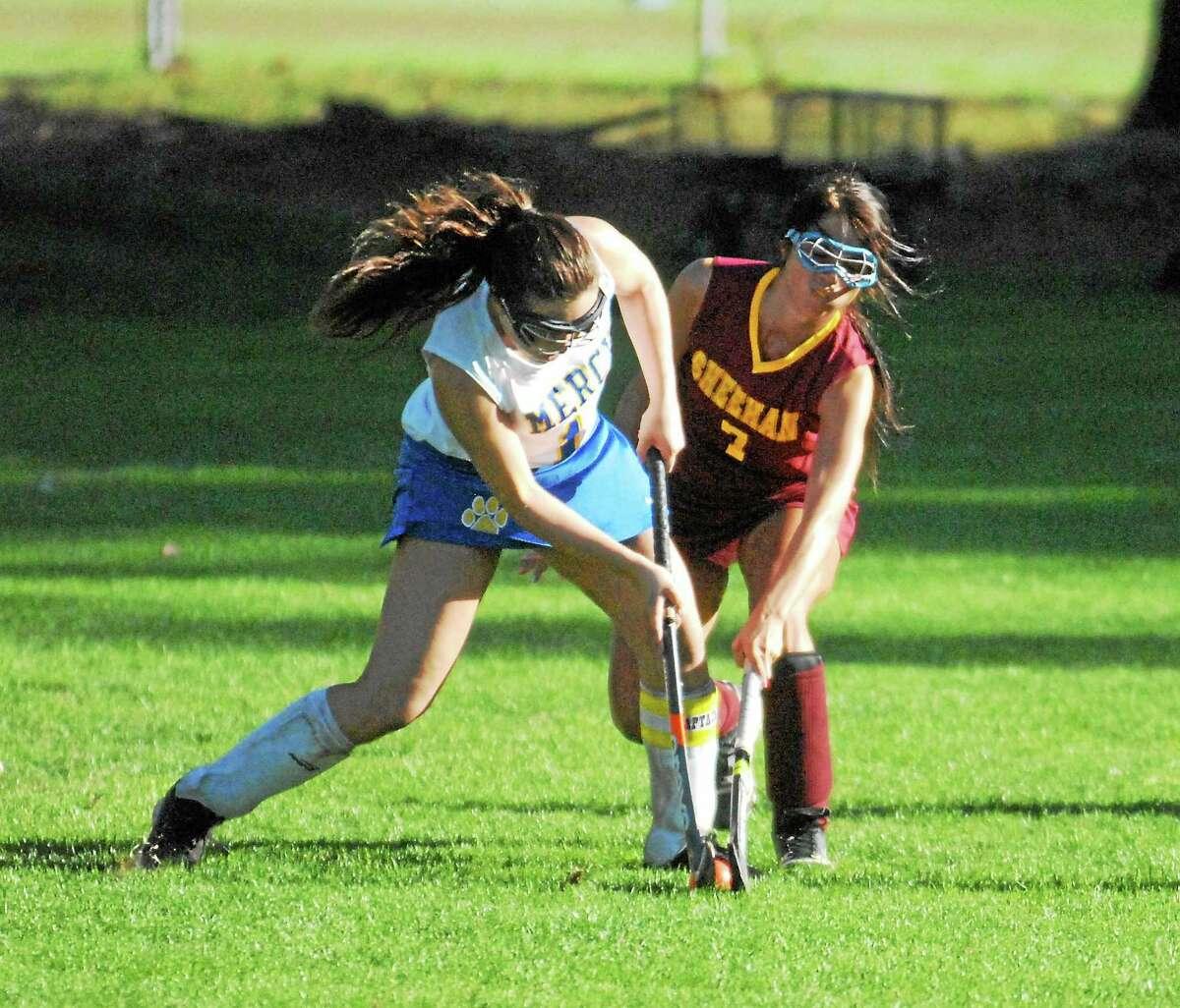 Mercy senior Juliana DellaCamera battles for the ball against Sheehan senior Jessica Berger on Friday.