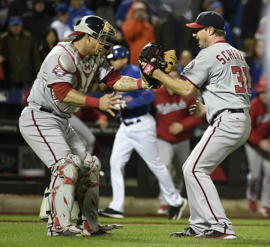 Nationals starting pitcher Max Scherzer (31) celebrates his no-hitter against the Mets with catcher Wilson Ramos on Saturday. Photo: Kathy Kmonicek — The Associated Press  / FR170189 AP