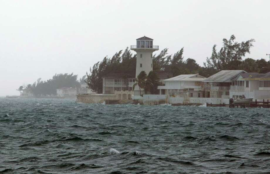 Wind and rain from Hurricane Joaquin affect Nassau, Bahamas, Friday, Oct. 2, 2015. Hurricane Joaquin dumped torrential rains across the eastern and central Bahamas on Friday as a Category 4 storm. Photo: (AP Photo/Tim Aylen) / AP
