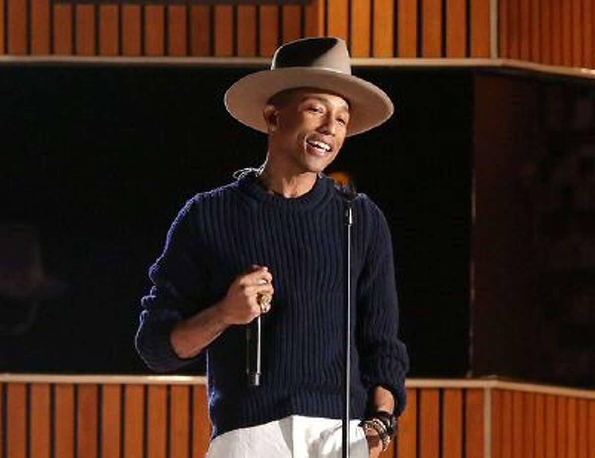 FILE - This Jan. 26, 2014 file photo shows Pharrell Williams on stage at the 56th annual Grammy Awards at Staples Center in Los Angeles. Oscars producers say in a news release Tuesday, Feb. 7, that Williams will sing his nominated song