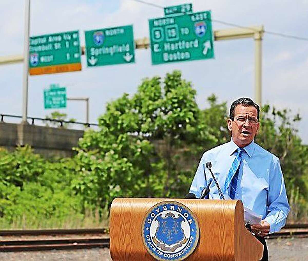 Gov. Dannel P. Malloy with the Charter Oak Bridge in Hartford in the background